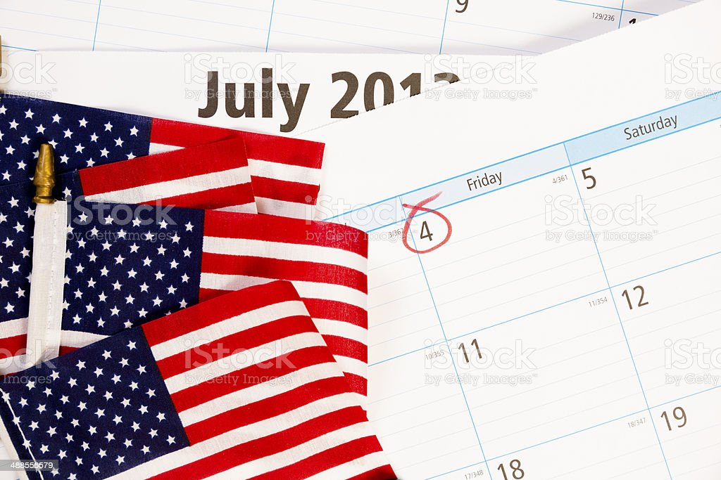 Holidays: July 4th circled on calendar with USA flags. royalty-free stock photo