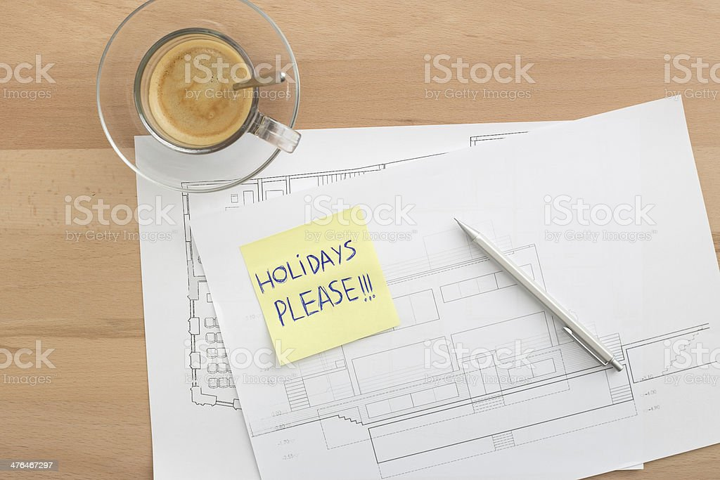Holidays please written on a post-it royalty-free stock photo