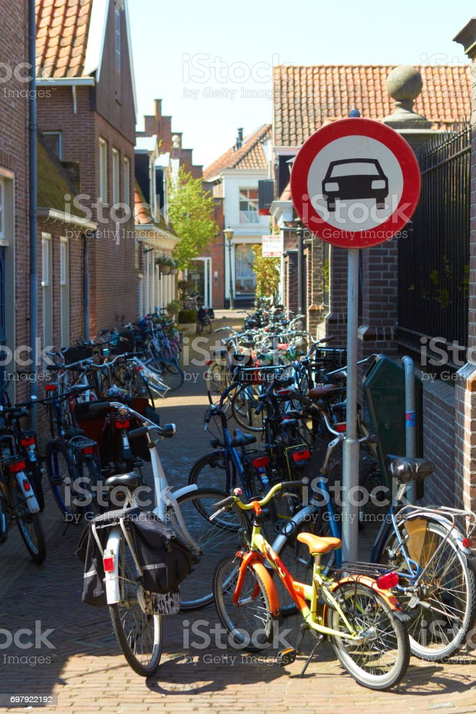 Holland city street no cars road sign: pedal cycles only bikes parking stock photo