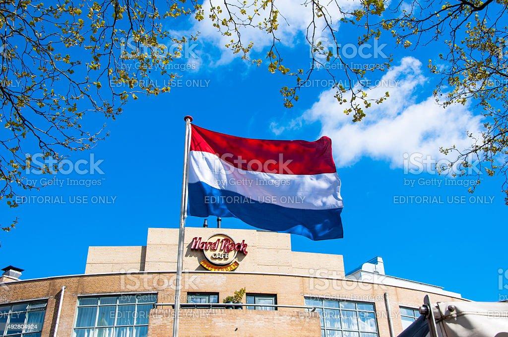 Holland flag and Hard Rock Cafe signage on the backgroud. stock photo