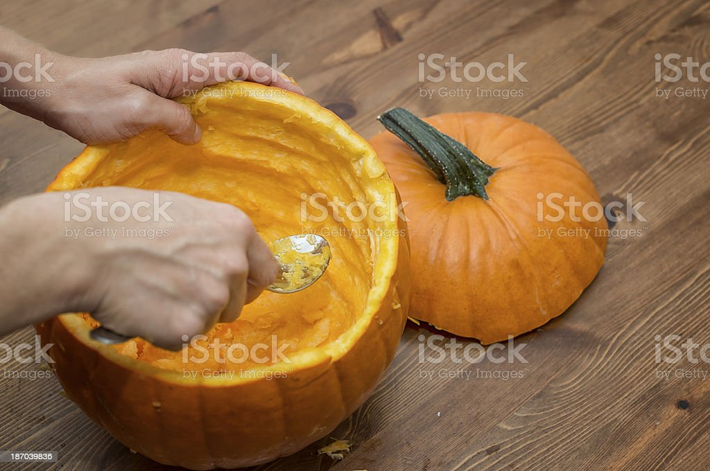 Hollow out a pumpkin on Halloween stock photo