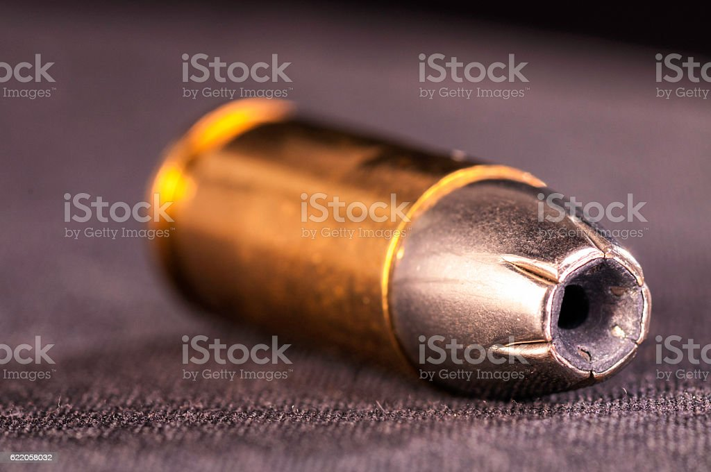 Hollow point 9mm bullet or ammunition laying on the side stock photo