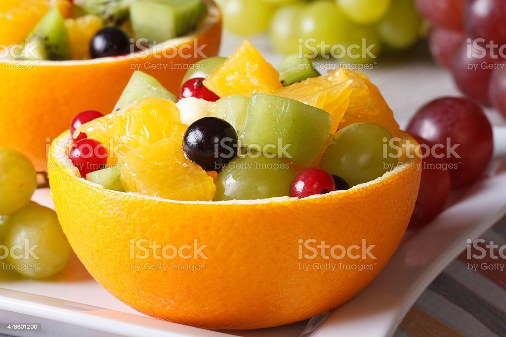 Hollowed-out oranges filled with fruit close-up horizontal stock photo