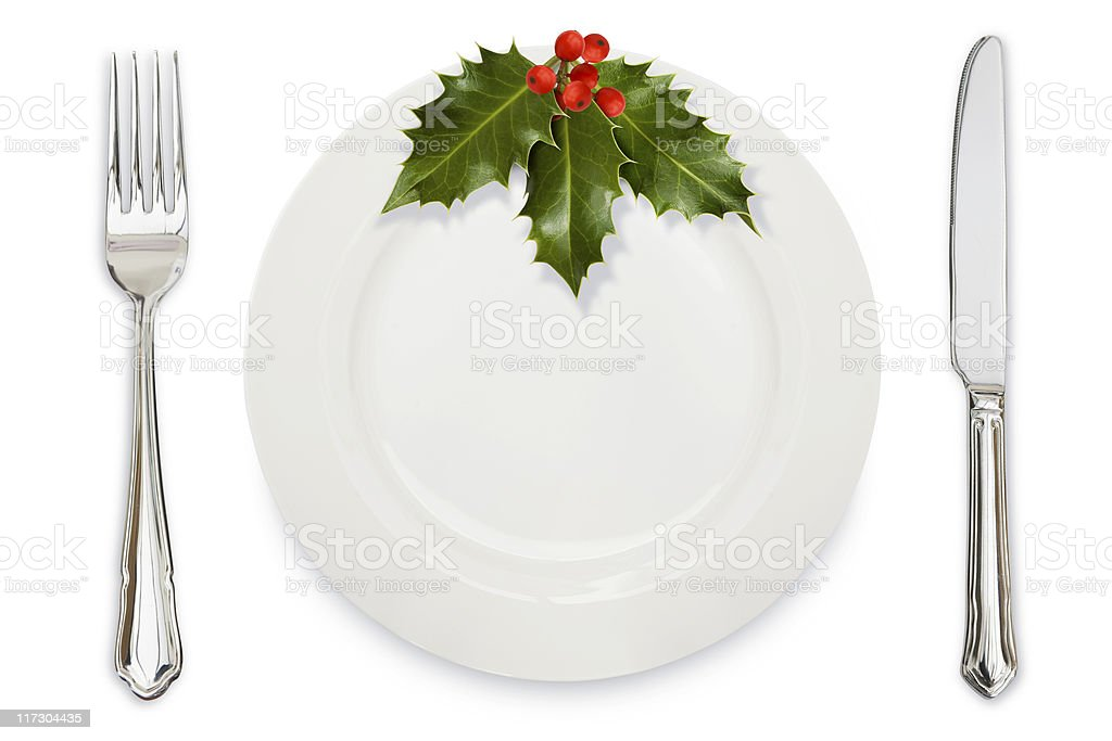 Holly Dinner plate knife and fork royalty-free stock photo