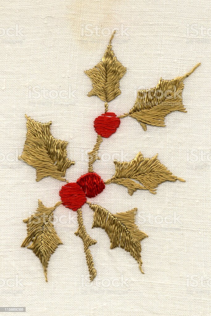 holly embroidering with leaves and berries royalty-free stock photo