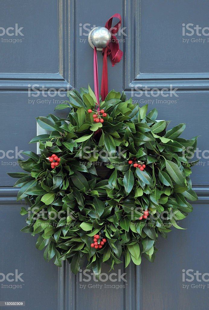 Holly wreath stock photo