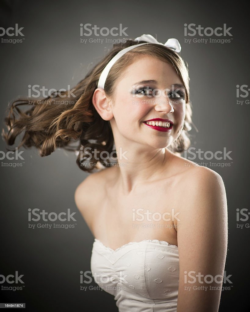 Hollywood style lighting and hair flip portrait stock photo