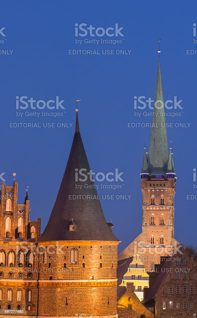 Holstein gate and Petri church by night in Lubeck stock photo