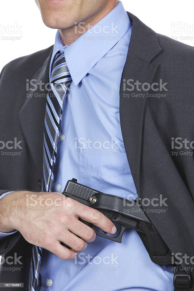 Holstering a gun. royalty-free stock photo