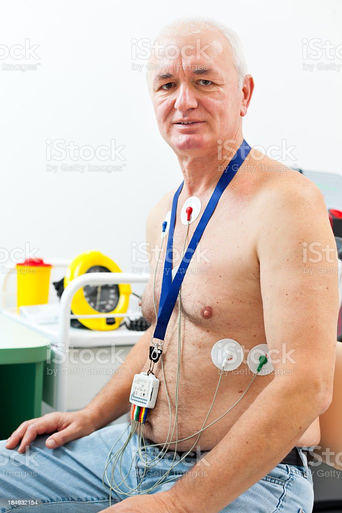 Holter monitor on patient's chest stock photo