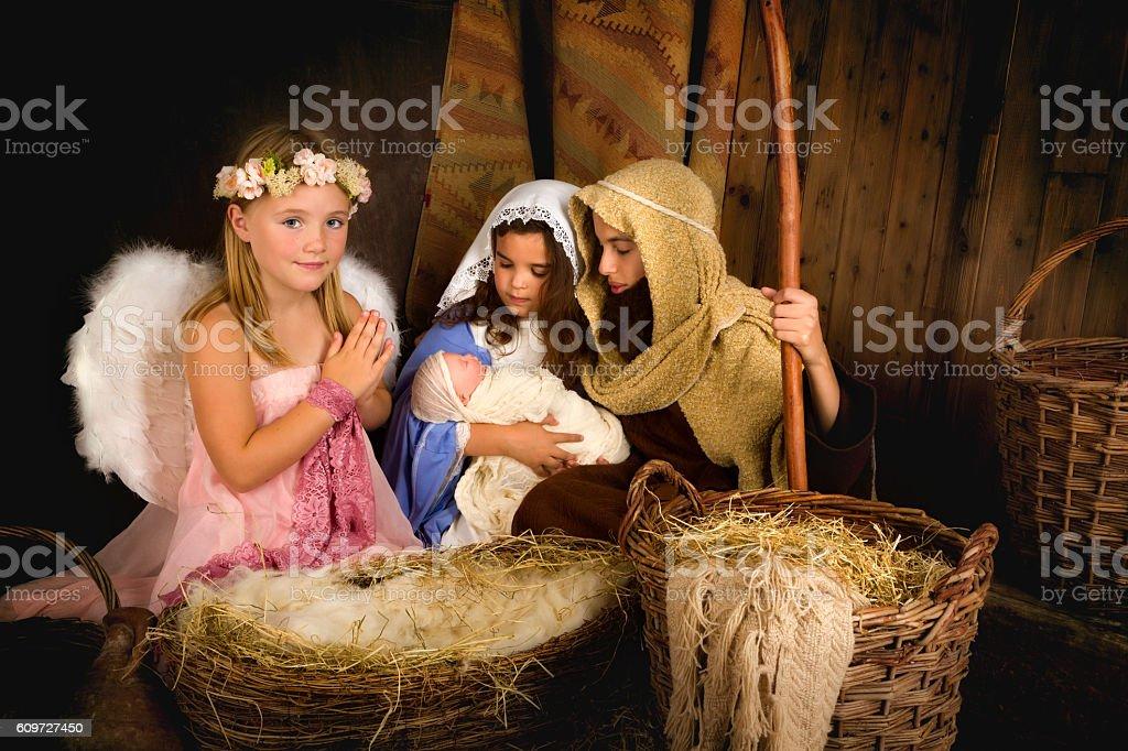 Holy Angel and nativity scene stock photo