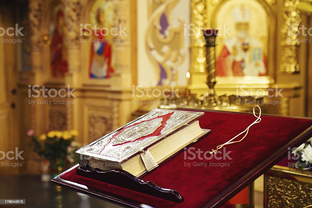 Holy Bible and cross in orthodox church royalty-free stock photo
