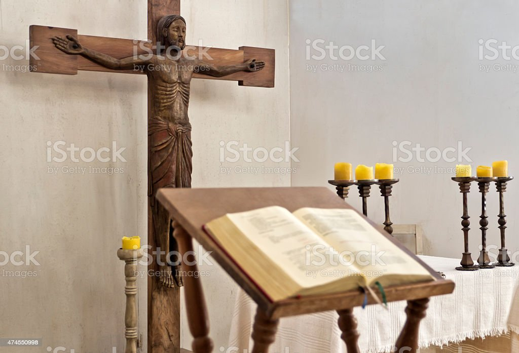 Holy Bible in austere altar of church stock photo