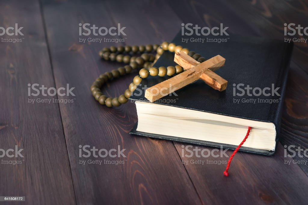 Holy Bible on a wooden table stock photo
