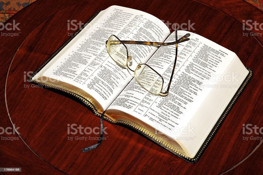 Holy Bible - Open, reading paused stock photo
