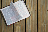 Holy Bible Turning Pages on Wooden Background