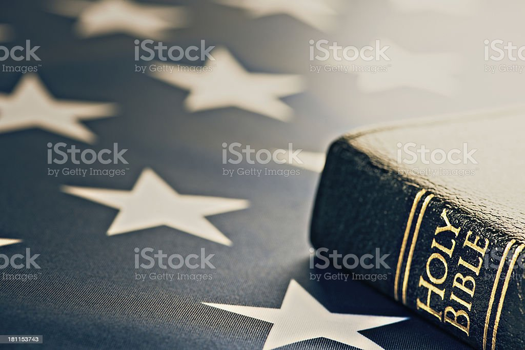 Holy Bible with American Flag stock photo