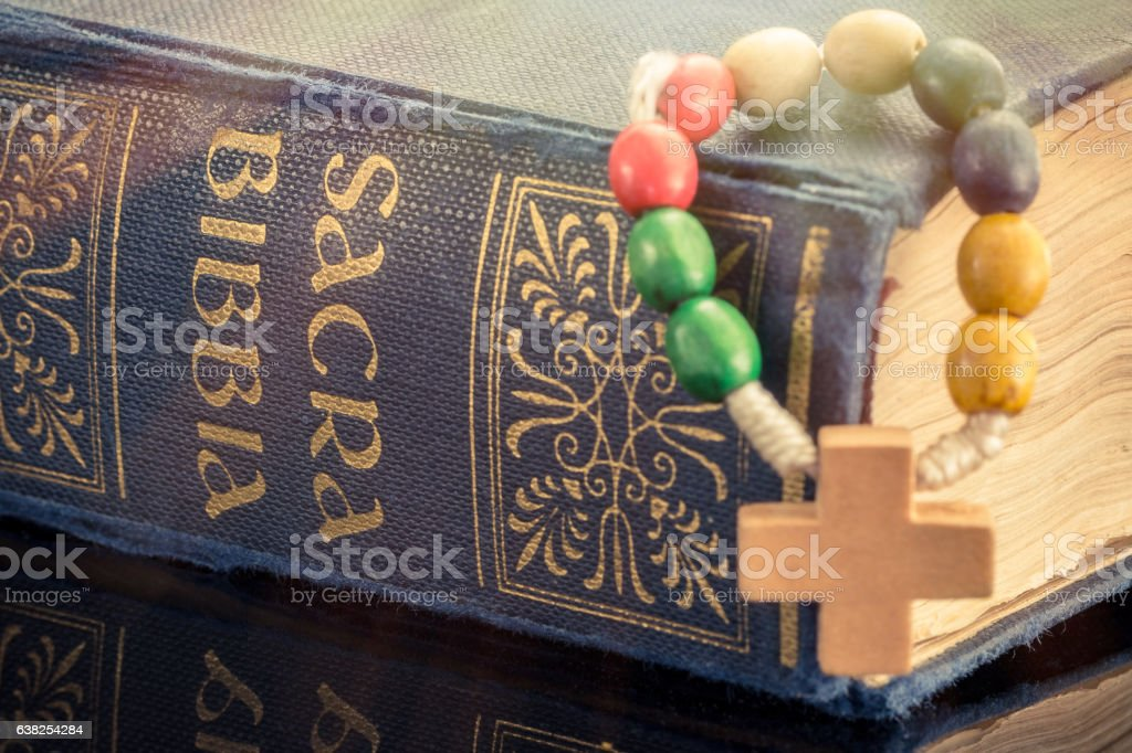 Holy Bible with cross stock photo