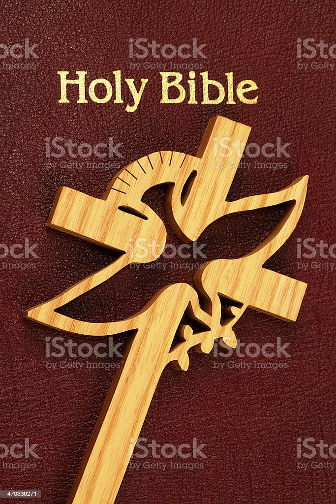 Holy Bible with Peace Dove Cross stock photo