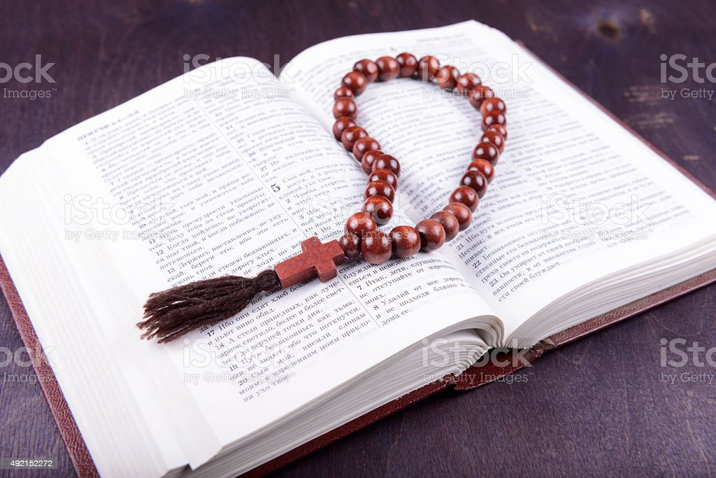 holy book and cross on a wooden background stock photo