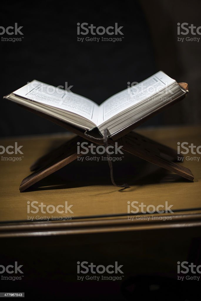 Holy book on wooden base stock photo