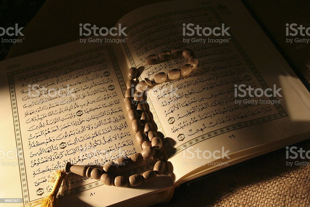 holy book & rosary stock photo