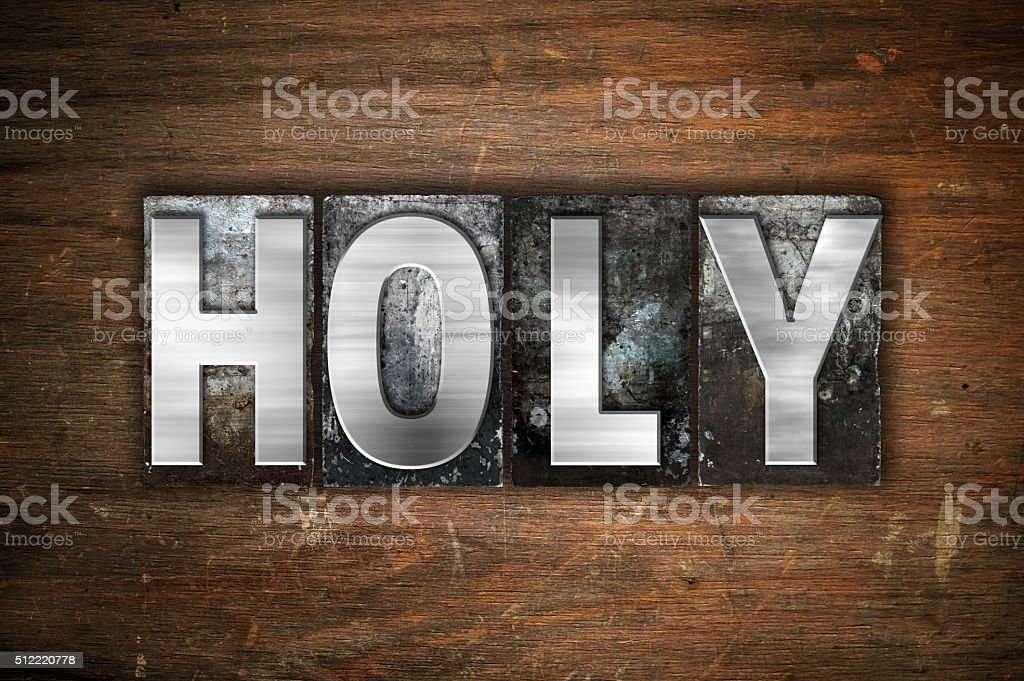Holy Concept Metal Letterpress Type stock photo