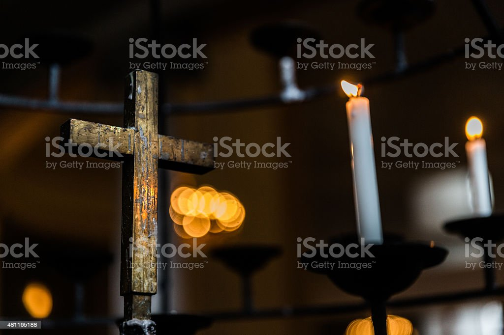 Holy cross and candles - Stock Image stock photo