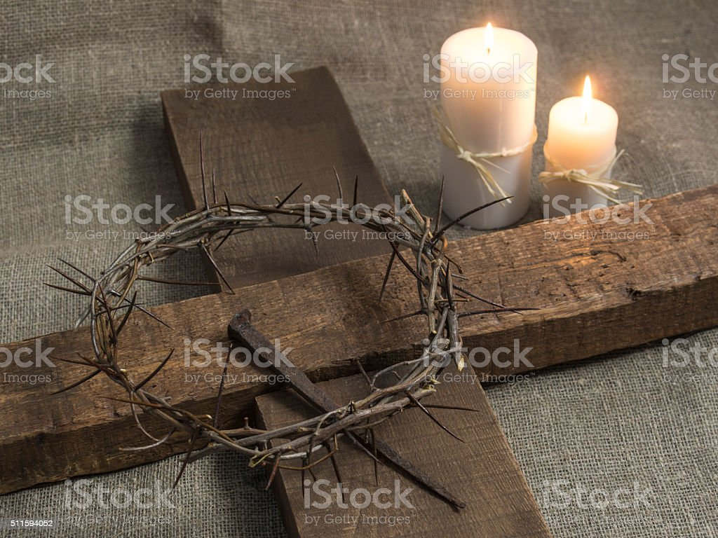 holy cross, crown of thorns and candles stock photo