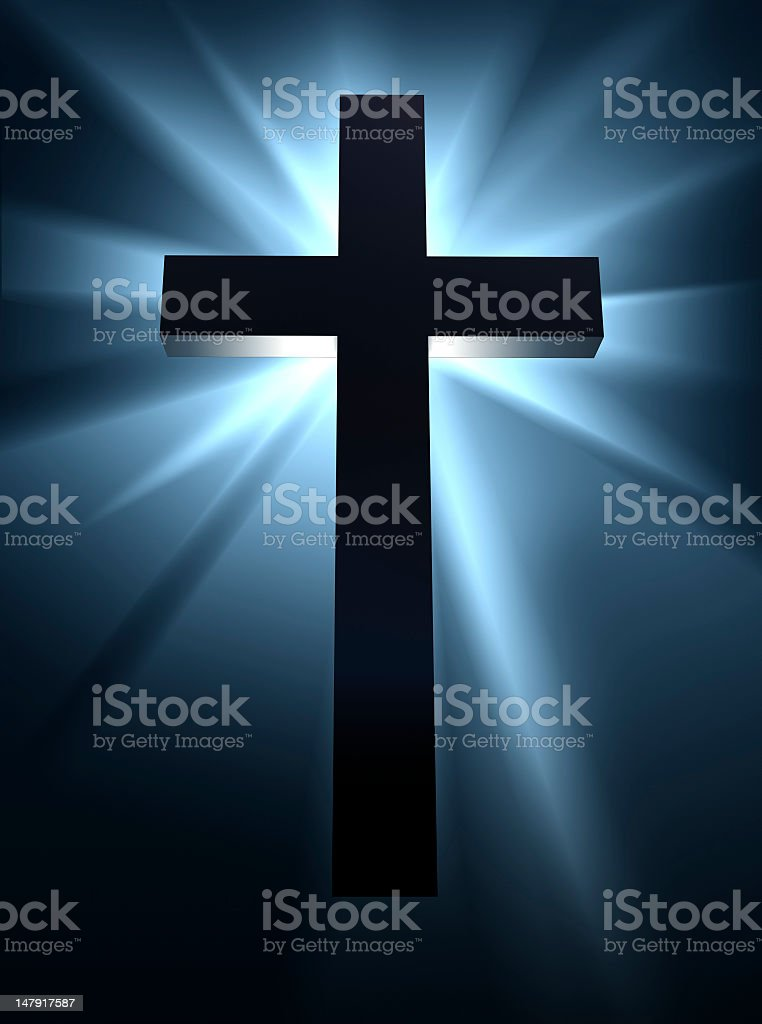 Holy cross silhouette backlit by a bright blue light royalty-free stock photo