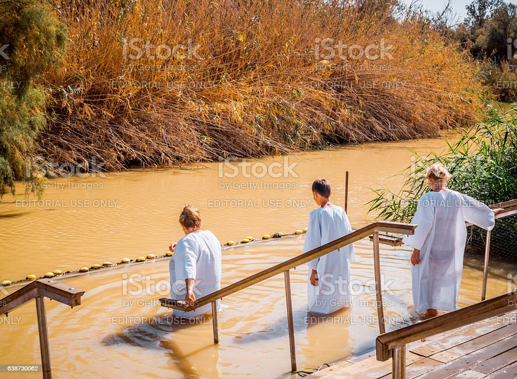 Holy dip in the river Jordan stock photo