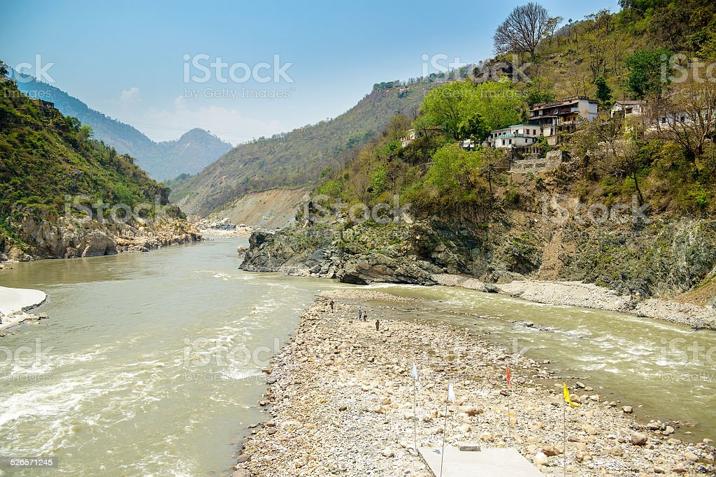 Holy Ganges river flows in a valley, India stock photo