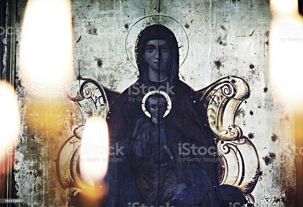 Holy icon and candles stock photo