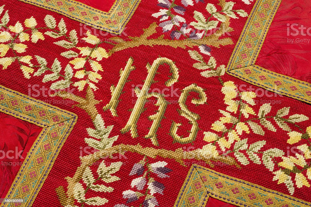 Holy IHS on vestment stock photo