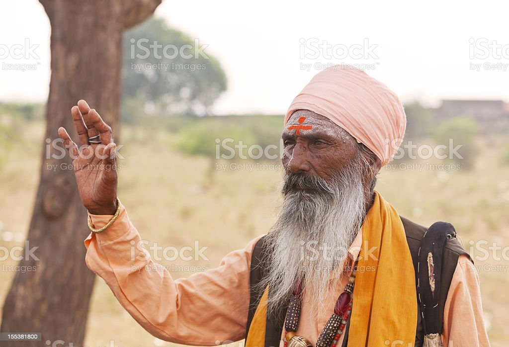 Holy indian man holding up his hand in blessing royalty-free stock photo