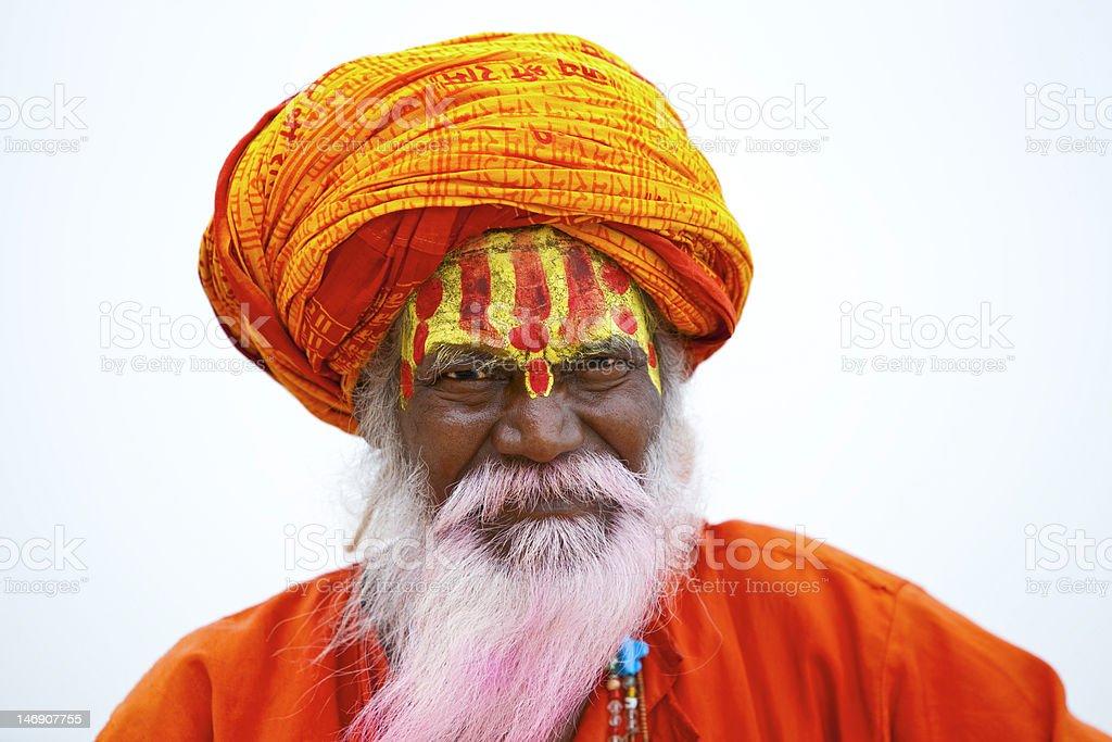 Holy Indian Sadhu in orange robe and turban stock photo