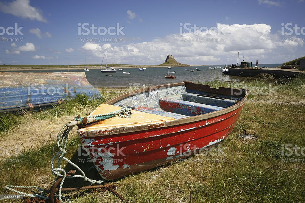 Holy Island Castle with red boat stock photo