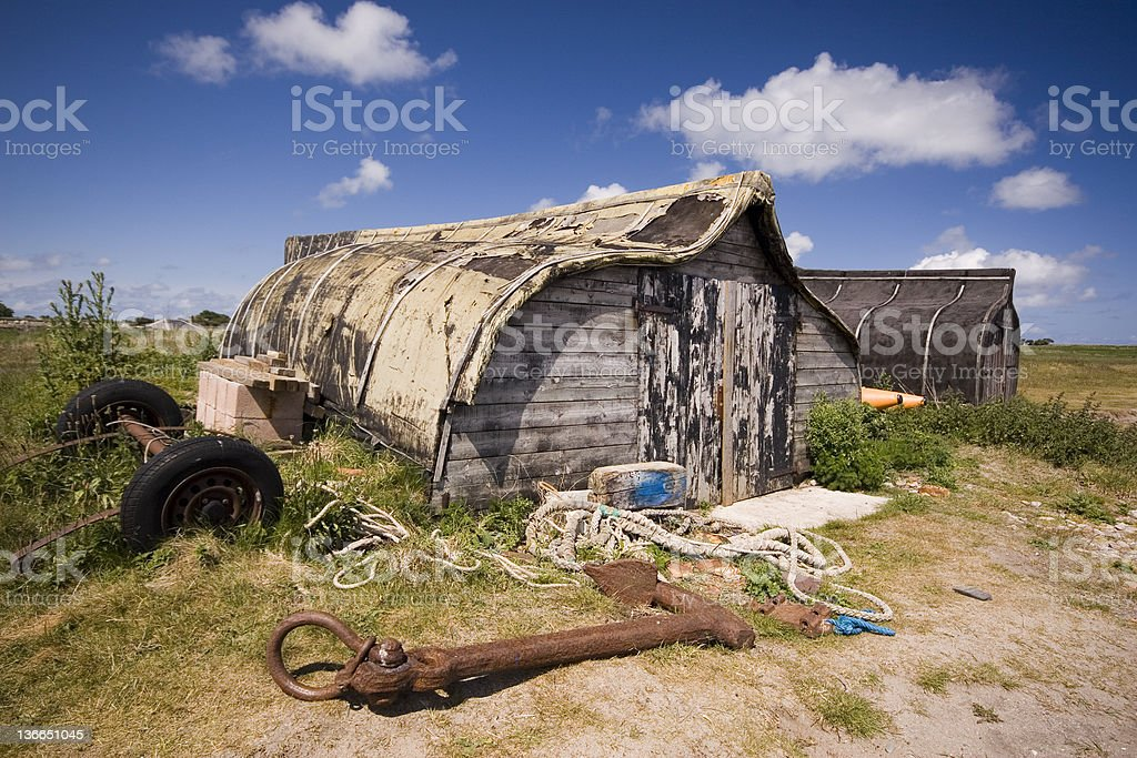 Holy Island Upturned boats and anchor stock photo