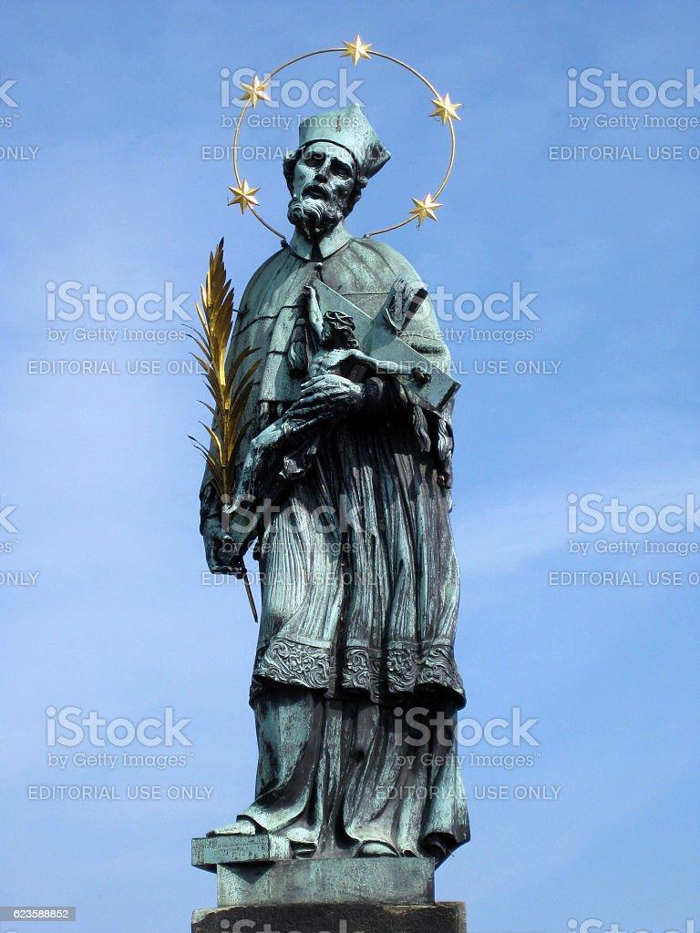 Holy John of Nepomuk statue on the Charles bridge stock photo