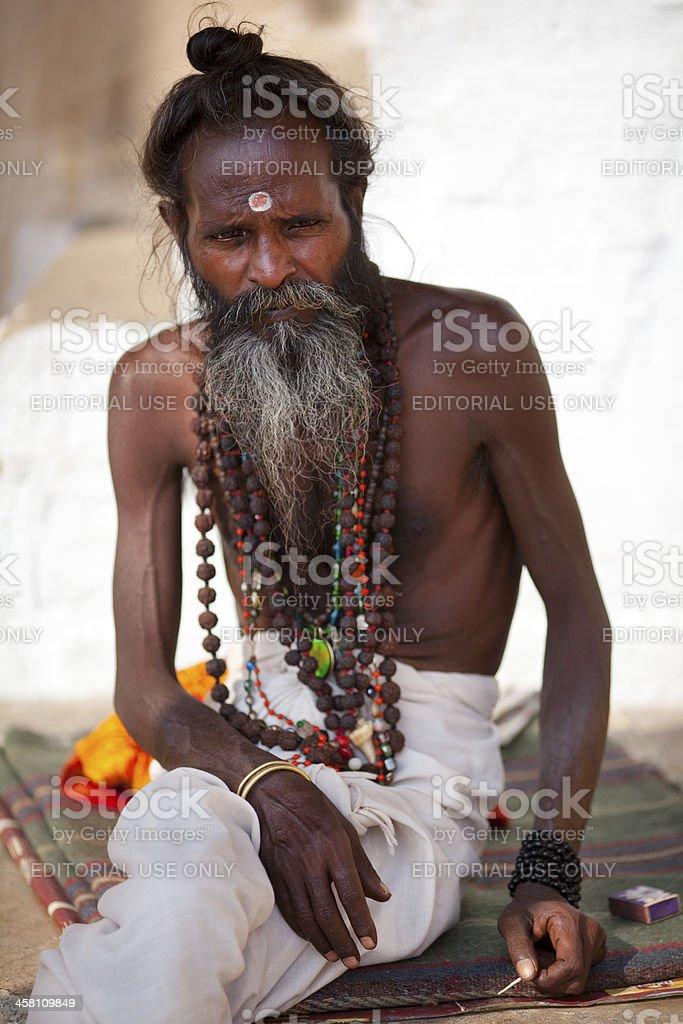 Holy man with bindi and buddhist prayer beads royalty-free stock photo