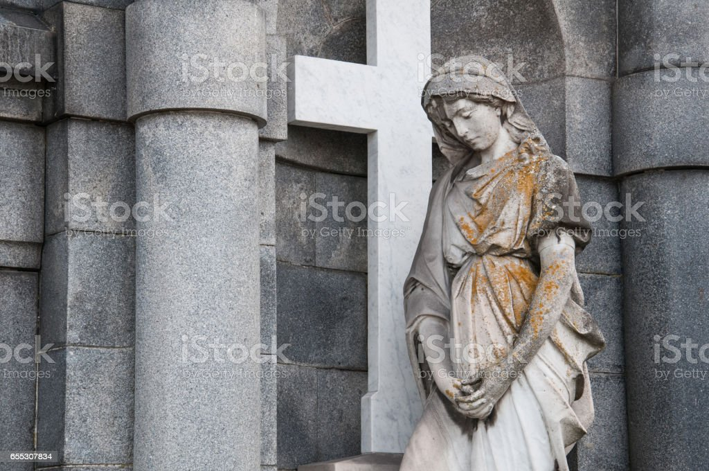holy Mary statue in front of a church stock photo