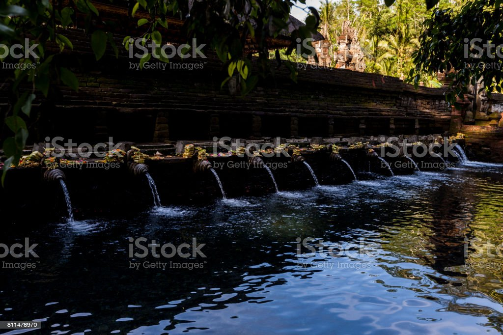 Holy Spring Water Tirta Empul Hindu Temple at Bali in Indonesia. stock photo