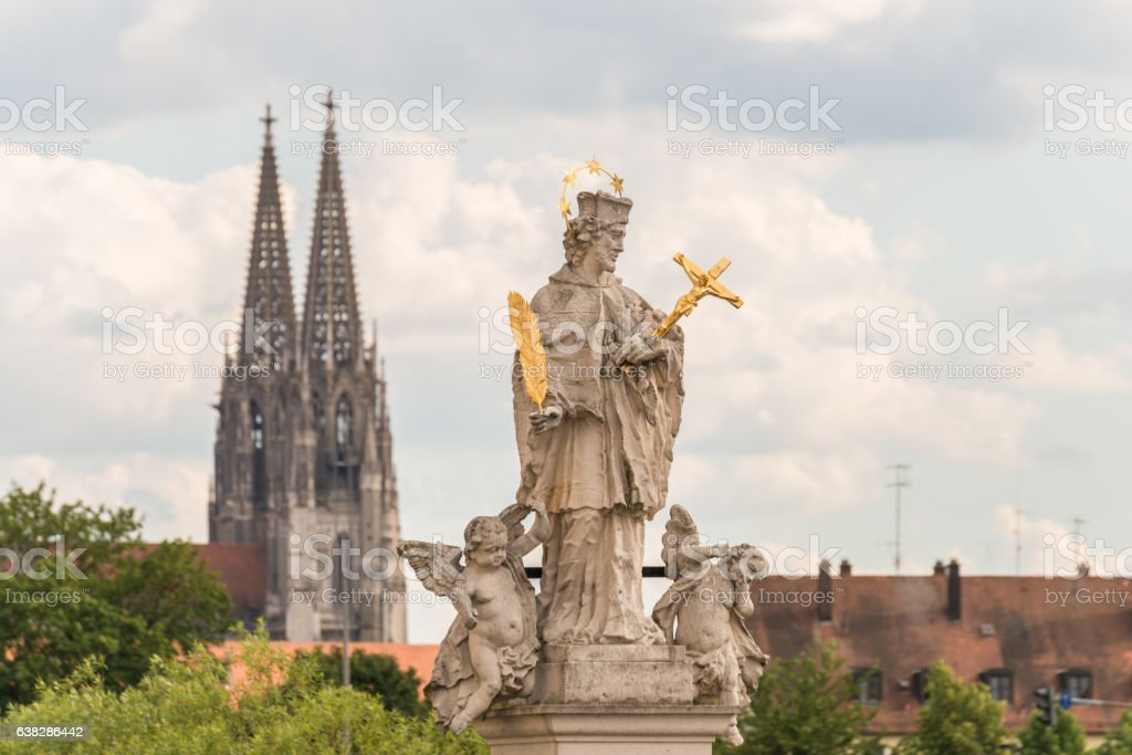 Holy Statue in regensburg with the dom in the background stock photo