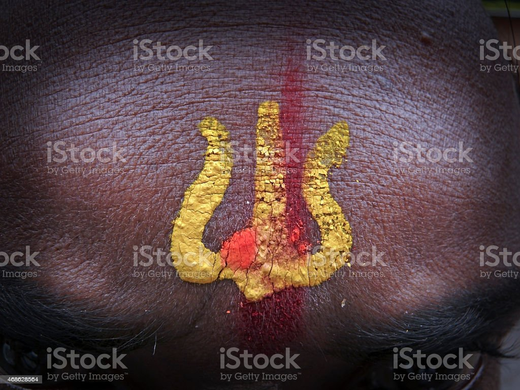 Holy symbol, Trishul on human forehead stock photo