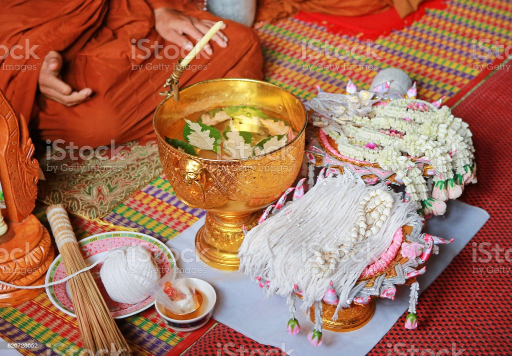 Holy thread, Thai holy thread and holy water for tied the hands in wedding ceremony. stock photo