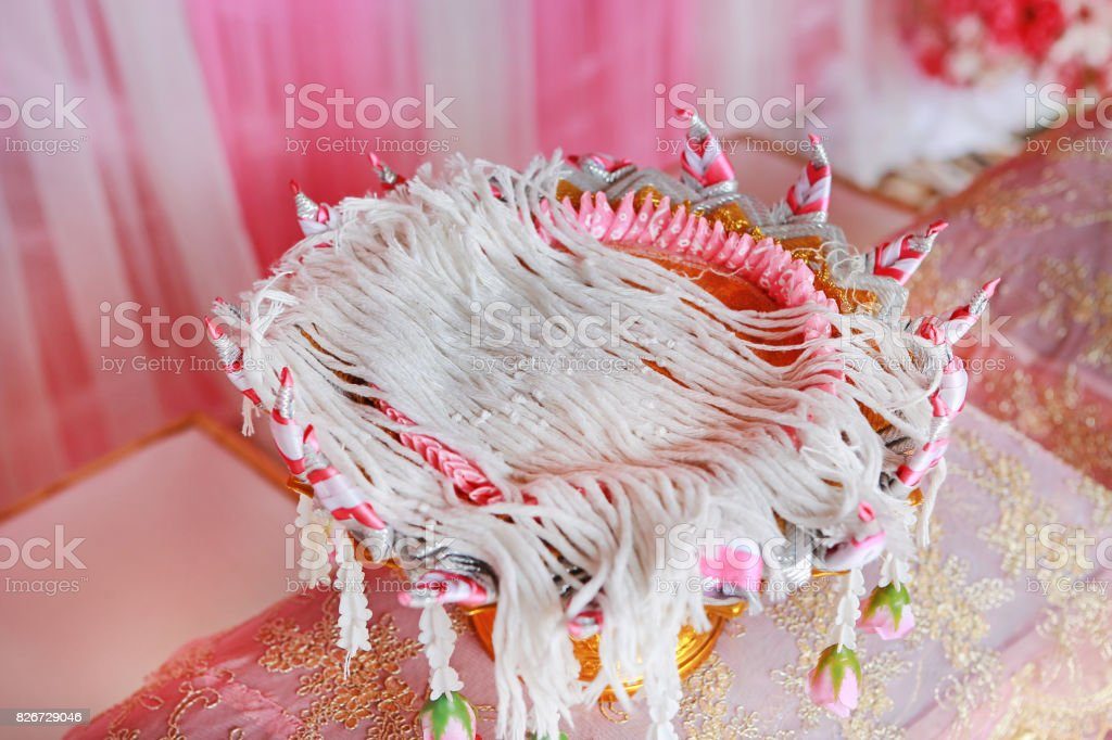 Holy thread, Thai holy thread for tied the hands in wedding ceremony. stock photo