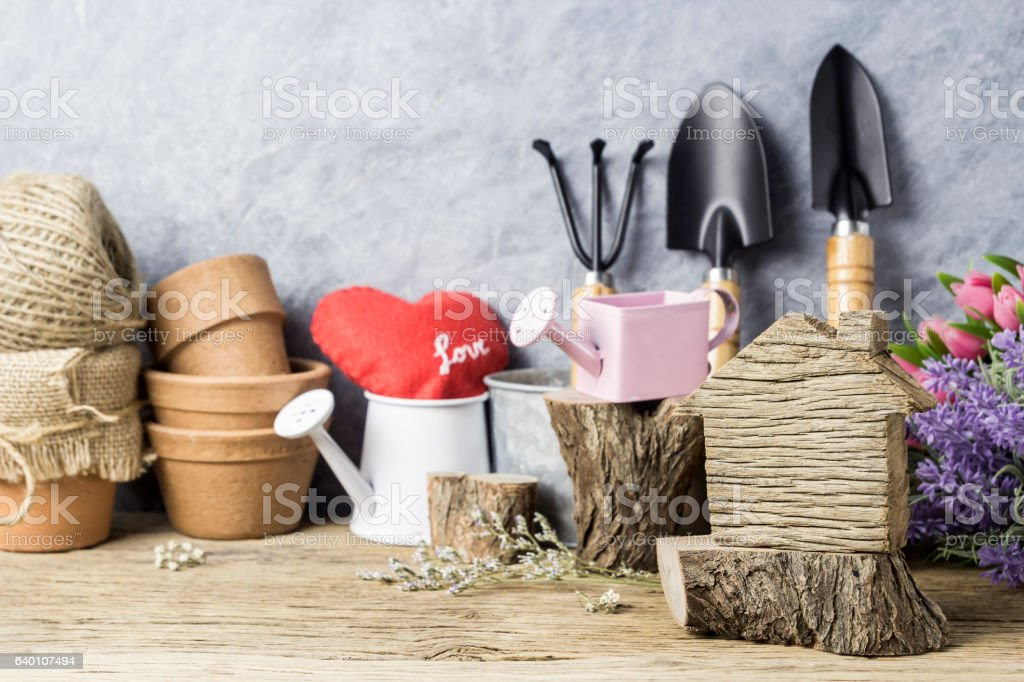 Home and garden concept of wood home and gardening tools stock photo