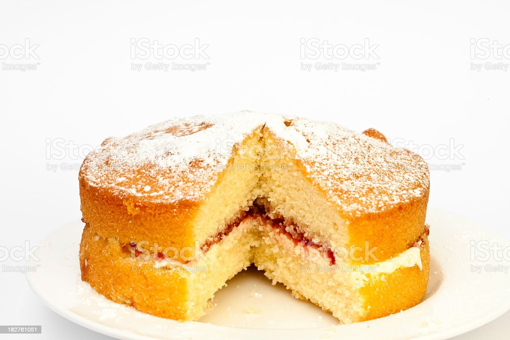 home baked jam and cream sponge cake with slice removed stock photo