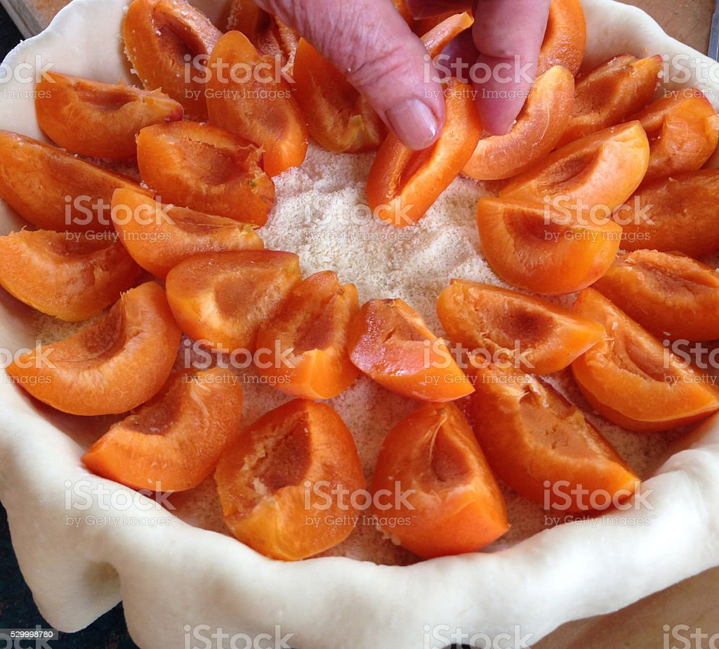 Home baking: making an apricot flan stock photo