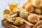 Home breakfast- bread rolls with egg and tea.
